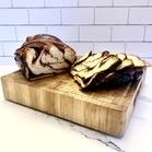 sliced cinnamon babkallah on a wooden cutting board