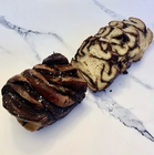 """Salted Chocolate """"Babkallah"""" on a white marble surface"""