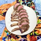 garlic herb lamb rack, sliced and displayed as chops splayed out in a fan