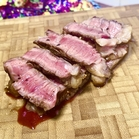 slices of Simple Grilled Steak on a carving board