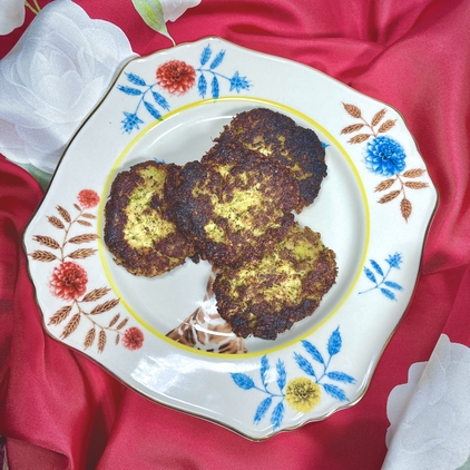 Grandma Mala's Veggie Patties on a floral china plate with a red silk scarf in the background